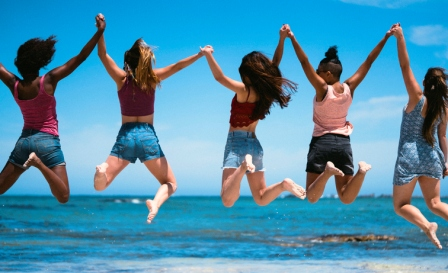 girls jumping together