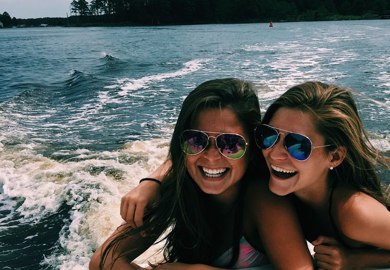 two young girls on boat laughing